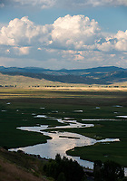 The evening sky illuminates Flat Creek as it winds through the National Elk Refuge on Monday evening. Flat Creek, which opened to fishing August 1, is considered by many anglers to be one of Jackson Hole's most challenging waterways to fish.