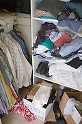 detail of a messy clothing walking in closet