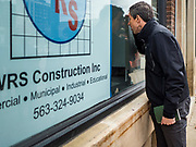 20 MAY 2019 - DAVENPORT, IOWA: BETO O'ROURKE looks into a flooded business in downtown Davenport. O'Rourke, running to be the 2020 Democratic nominee for the US Presidency, has made climate change a central part of his campaign. He toured flood damage in Davenport Monday. The Mississippi River flooded through downtown Davenport on April 30 and much of downtown is still recovering from the flood.     PHOTO BY JACK KURTZ