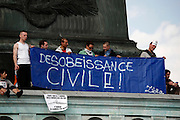Civil Disobedience, May Day March, Paris, 1 May 2009. Protestors on the Colonne de Juillet being rather literal and obvious with Desobeissance Civil banner.