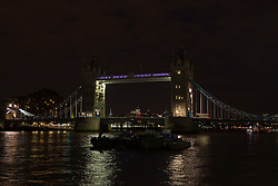 © Licensed to London News Pictures. 05/07/2014. London, UK. Tower Bridge in London is seen with lights switched off. Landmarks across London and the UK are turning their lights off from 10pm to 11pm tonight to mark the First World War centenary. Photo credit : Vickie Flores/LNP