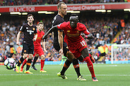 Sadio Mane of Liverpool is tackled by David Meyler of Hull City. Premier League match, Liverpool v Hull City at the Anfield stadium in Liverpool, Merseyside on Saturday 24th September 2016.<br /> pic by Chris Stading, Andrew Orchard sports photography.