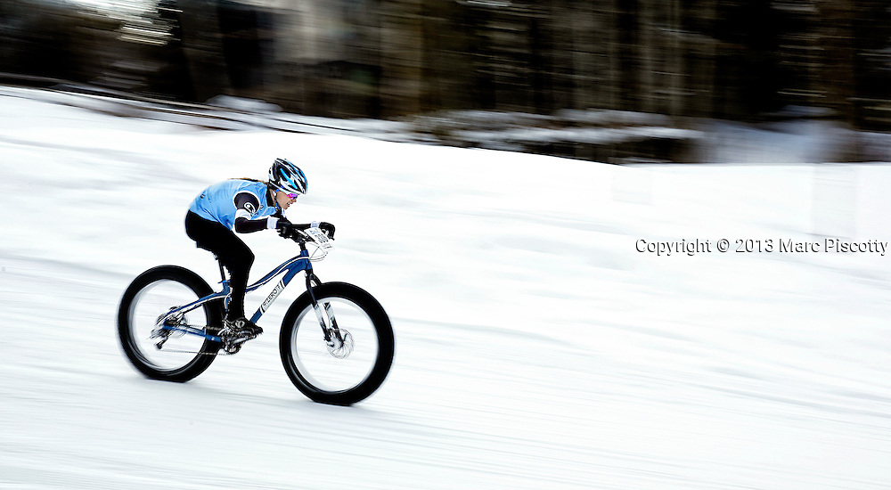 SHOT 2/8/13 3:58:23 PM - Judy Freeman of Boulder, Co. competes in the 20K X-Country On-Snow Mountain Bike Race at the second annual Winter Mountain Games presented by Eddie Bauer at Vail Ski Resort in Vail, Co. The Winter Mountain Games feature competitions in X-Country On-Snow Mountain Bike Races, mixed climbing, Telemark Big Air,Best Trick Bike and On-Snow Mountain Bike Crit with more than $60,000 in prize money on the line. (Photo by Marc Piscotty / © 2013)