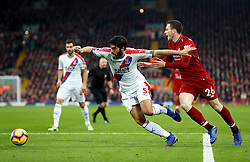 Crystal Palace's James Tomkins (left) and Liverpool's Andrew Robertson battle for the ball during the Premier League match at Anfield, Liverpool.