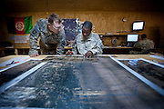 A U.S. Army captain reviews a map of his area of operations before a major joint operation in Zhari District, Kandahar Province.