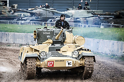"""A T67003 Valentine Mark IX tank, drives around the tank course at the Tank Museum in Bovington, Dorset, as the attraction hosts """"Tiger Day"""" to mark the 75th anniversary of the world's only working Tiger Tank's capture in 1943 in the Tunisian desert."""