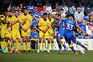 AFC Wimbledon striker Lyle Taylor (33) with a shot on goal from a free kick during the EFL Sky Bet League 1 match between AFC Wimbledon and Bristol Rovers at the Cherry Red Records Stadium, Kingston, England on 8 April 2017. Photo by Matthew Redman.