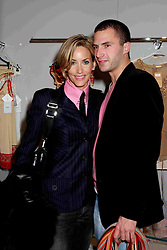 LISA BUTCHER and boyfriend DAN at the launch of the Essenziale shop, Grafton Street, London on 12th December 2006.<br />