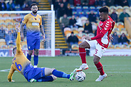 Neal Bishop of Mansfield Town (6) tackles Nicky Ajose of Charlton Athletic (25) during the The FA Cup match between Mansfield Town and Charlton Athletic at the One Call Stadium, Mansfield, England on 11 November 2018.
