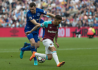 Football - 2017 / 2018 Premier League - West Ham United vs. Everton<br /> <br /> Mario Lanzini (West Ham United)  gets the ball caught up and allows Michael Keane (Everton FC ) to make the tackle  at the London Stadium<br /> <br /> COLORSPORT/DANIEL BEARHAM