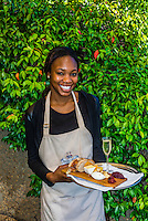 """A waitress holds a local cheese platter accompanied by Pierre Jordan Ratafia wine, the last of a six course """"Taste of Summer"""" lunch menu, restaurant at Haute Cabriere Vineyard Estate, Franschhoek Pass, Franschhoek, Cape Winelands, South Africa."""