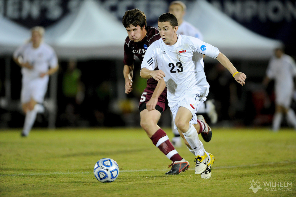 02 DEC 2011: Matt Shadoan (23) of Ohio Wesleyan University races ahead of Sean Broekhuizen (5) of Calvin College during the Division III Men's Soccer Championship held at Blossom Soccer Stadium hosted by Trinity University in San Antonio, TX. Ohio Wesleyan defeated Calvin 2-1 to win the national title. © Brett Wilhelm