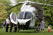 MD902 Explorer helicopter from the Kent, Surrey & Sussex Air Ambulance Trust on the ground in Ruskin Park after emergency flight to Kings College Hospital in south London.