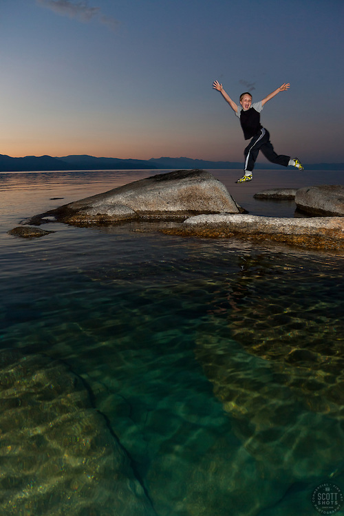 """""""Boy at Lake Tahoe 3"""" - This boy was photographed near Speedboat Beach, Lake Tahoe,  jumping from rock to rock at sunrise."""