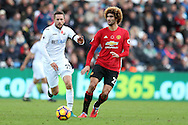 Gylfi Sigurdsson of Swansea city (l) goes past Marouane Fellaini of Manchester Utd. Premier league match, Swansea city v Manchester Utd at the Liberty Stadium in Swansea, South Wales on Sunday 6th November 2016.<br /> pic by  Andrew Orchard, Andrew Orchard sports photography.