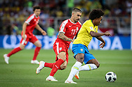 Willian of Brazil and Aleksandar Kolarov of Serbia during the 2018 FIFA World Cup Russia, Group E football match between Erbia and Brazil on June 27, 2018 at Spartak Stadium in Moscow, Russia - Photo Thiago Bernardes / FramePhoto / ProSportsImages / DPPI