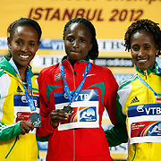 Kenya's gold medallist Hellen Obiri (C) poses on the podium with Ethiopia's silver medal winner Meseret Defar (L) and bronze medallist Gelete Burka during the medal ceremony for the women's 3000m at the IAAF World Indoor Championships at the Atakoy Athletics Arena, Istanbul, Turkey. Photo by TURKPIX