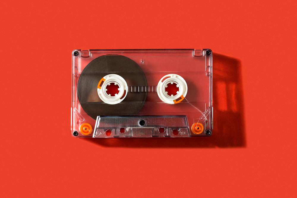 Old vintage cassette tape on a red background