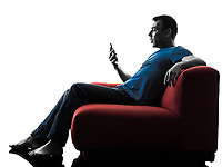 one caucasian man sofa couch on the telephone in silhouette isolated on white background