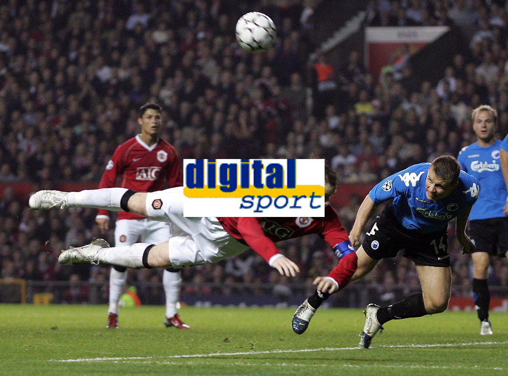 Photo: Paul Thomas.<br /> Manchester United v FC Copenhagen. UEFA Champions League, Group F. 17/10/2006.<br /> <br /> Michael Gravgaard (14) of Copenhagen clears the ball away after Wayne Rooney (L) just misses with his header.