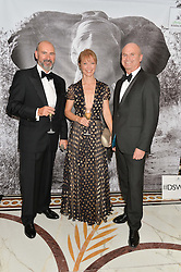 Left to right, OLIVER CLEAVER, his wife design consultant and interior designer NAOMI CLEAVER and Television presenter and cameraman, specialising in nature documentaries SIMON KING at the David Shepherd Wildlife Foundation 30th anniversary Wildlife Ball at The Dorchester, Park Lane, London on 10th October 2014.