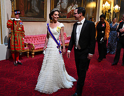 The Duchess of Cambridge and United States Secretary of the Treasury, Steven Mnuchin arrive through the East Gallery during the State Banquet at Buckingham Palace, London, on day one of the US President's three day state visit to the UK.