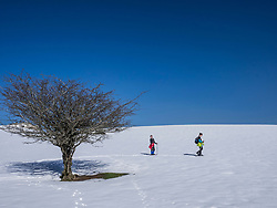Mother and daughter on snowshoe tour at Mount Gorbea, Biscay, Basque Country, Spain