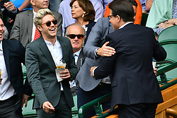 © Licensed to London News Pictures. 04/07/2016. NIALL HORAN of ONE DIRECTION and MICHAEL MCINTYRE and watche tennis on the centre court on the seventh day of the WIMBLEDON Lawn Tennis Championships. London, UK. Photo credit: Ray Tang/LNP