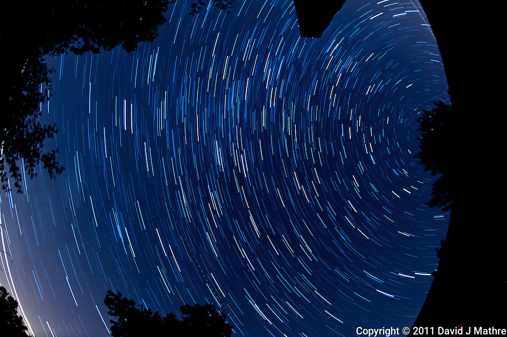 North View Star Trails. Summer Night in New Jersey. Image taken with a Nikon D3s and 16 mm f/2.8 mm Fisheye lens (ISO 400, 16 mm, f/4, 59 sec). Composite of 30 images combined using the Startrails program.