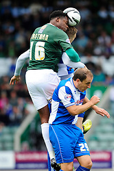 Bristol Rovers' Ryan Brunt challenges Plymouth Argyle's Neal Trotman to the header  - Photo mandatory by-line: Dougie Allward/JMP - Tel: Mobile: 07966 386802 07/09/2013 - SPORT - FOOTBALL -  Home Park - Plymouth - Plymouth Argyle V Bristol Rovers - Sky Bet League Two