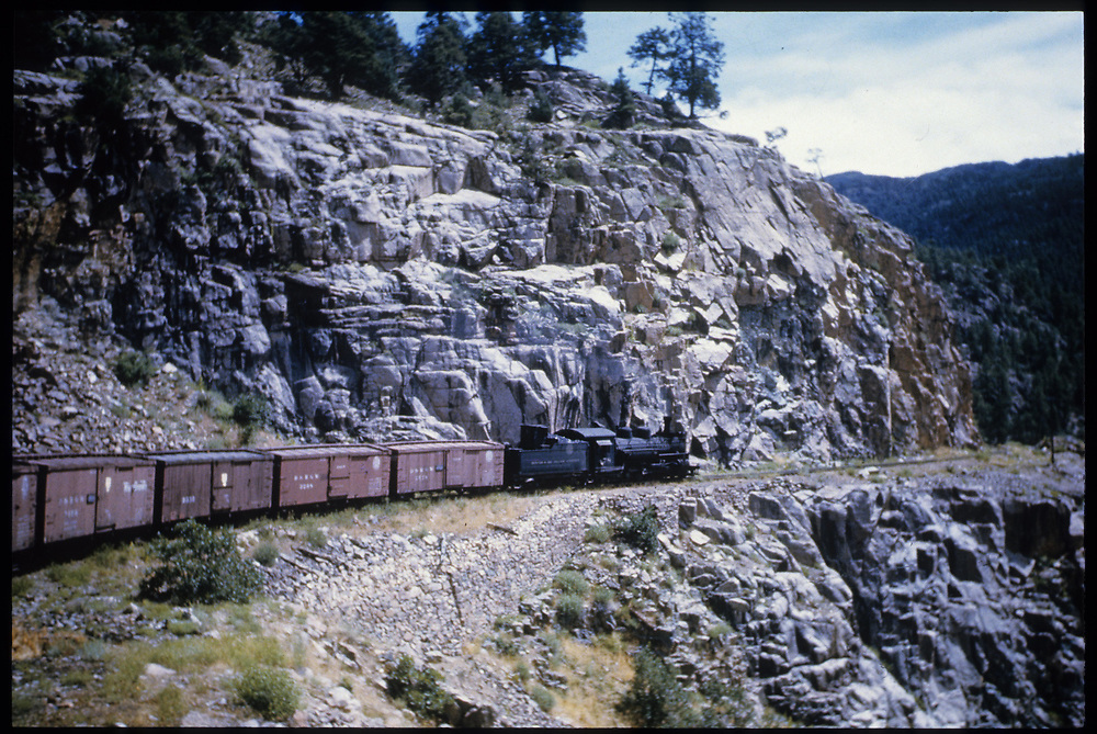 Engine with box cars on High Line out of Rockwood on Durango & Silverton Line.<br /> D&S  High Line, CO