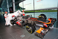 """© London News Pictures. 31/01/2013 . Woking, UK.  Team McLaren Mercedes drivers Jenson Button (right) and Sergio """"Checo"""" Perez (left) unveil the new MP4-28 Formula 1 car at the McLaren Technology Centre in Woking, Surrey, UK on  Thursday, Jan. 31, 2013. Photo credit : Ben Cawthra/LNP"""