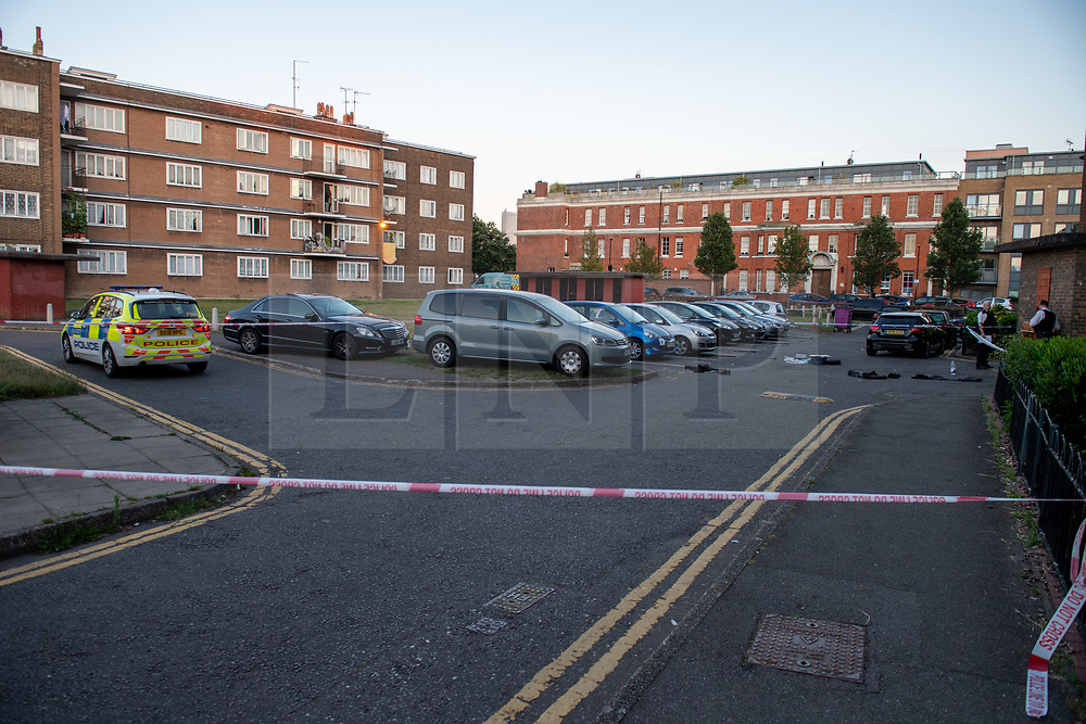 © Licensed to London News Pictures. 20/07/2020. London, UK. Police tape marks a crime scene outside Paterson House as police launch an investigation after two people were stabbed in Tower Hamlets. Photo credit: Peter Manning/LNP