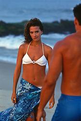 woman flirting with a man on the beach