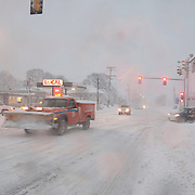 Very little morning rush hour traffic moves in the small Massachusetts town of Wakefield during a major blizzard