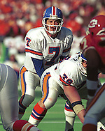 Denver quarterback John Elway (7) gets ready to take the snap against the Kansas City Chiefs at Arrowhead Stadium in Kansas City, Missouri in 1993.