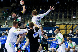 Fabian Wiede of Germany vs Matej Gaber of Slovenia during handball match between National Teams of Germany and Slovenia at Day 2 of IHF Men's Tokyo Olympic  Qualification tournament, on March 13, 2021 in Max-Schmeling-Halle, Berlin, Germany. Photo by Vid Ponikvar / Sportida