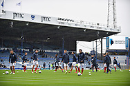 Portsmouth Players warm up in the rain during the EFL Sky Bet League 1 match between Portsmouth and Wycombe Wanderers at Fratton Park, Portsmouth, England on 22 September 2018.
