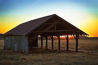 An old empty hay barn at sunset. This one is for wider format prints.