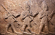 Image of Neo-Hittite orthostat with releif sculpture of 3 soldiers from the legend of Gilgamesh from Karkamis, Turkey, An Ankara Museum of Anatolian Civilizations exhibit.