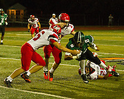 Nathan Womack is surrounded by Mustang defenders after a pass rrceptionduring Thursday night's game at Harve Collins Field. - Nicholas Rutledge / The Transcript (Published on Friday, October 10, 2014)