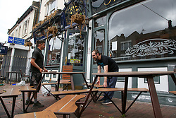© Licensed to London News Pictures. 08/06/2020. London, UK. Workmen prepare for social distancing at 'The Toll Gate' pub in north London. It has been reported that pubs and restaurants in England could reopen on 22 June to serve customers outdoors. Photo credit: Dinendra Haria/LNP