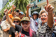 """25 MAY 2014 - BANGKOK, THAILAND: Thai """"Red Shirt"""" supporters of the ousted civilian government at a demonstration against the military junta. Public opposition to the military coup in Thailand grew Sunday with thousands of protestors gathering at locations throughout Bangkok to call for a return of civilian rule and end to the military junta.     PHOTO BY JACK KURTZ"""