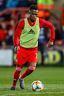 Wales midfielder Rabbi Matondo warms up during the Friendly European Championship warm up match between Wales and Trinidad and Tobago at the Racecourse Ground, Wrexham, United Kingdom on 20 March 2019.