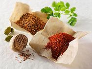 Ground & whole nutmeg, ground chilli powder & fresh coriander leaves
