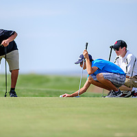 010110       Adron Gardner/Independent<br /> <br /> Gallup Bengal Charleston White, left, sets down a ball marker with Los Lunas Tiger Gabe Gamboa and Grants Pirate J.T. Goodart on the putting green during the district golf tournament at the Coyote Del Malpais Golf Course in Grants Monday.
