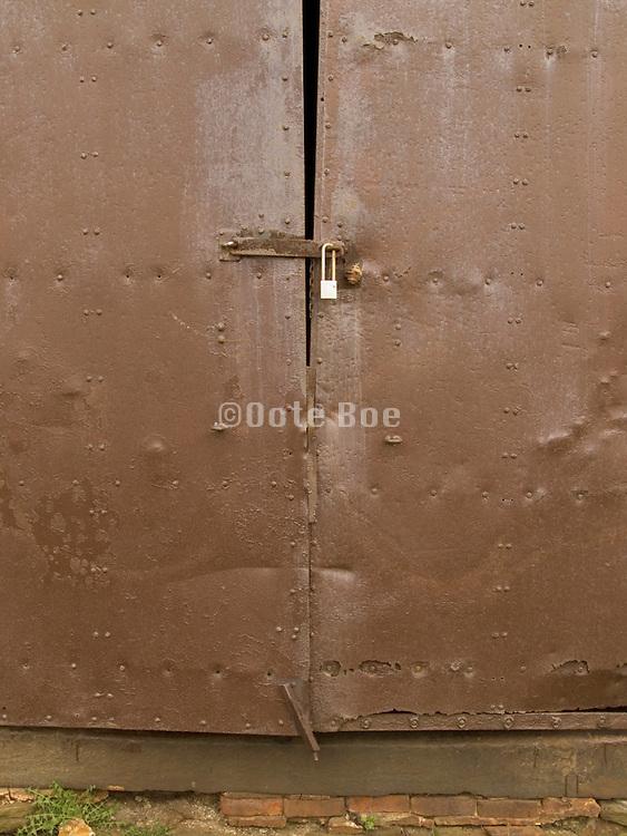 old metal door locked with a padlock