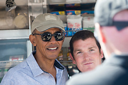 Former US president Barack Obama playing golf at St Andrews. With Sir Tom Hunter in the kiosk.