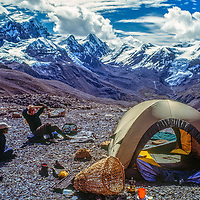 Meredith Wiltsie and Tibetan porter Tsering relax atop 17,769-foot Thorang La pass north of Annapurna in Nepal.