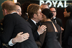 The Duke and Duchess of Sussex embrace David Furnish and Elton John at the European Premiere of Disney's The Lion King at the Odeon Leicester Square, London.